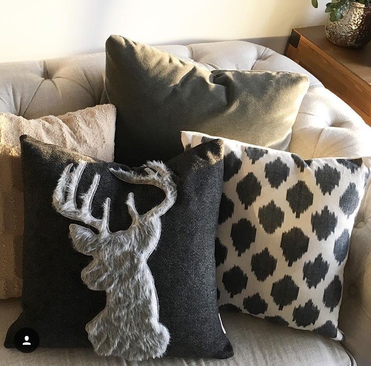 My new favorite reindeer pillow (from Homegoods)on the sofa