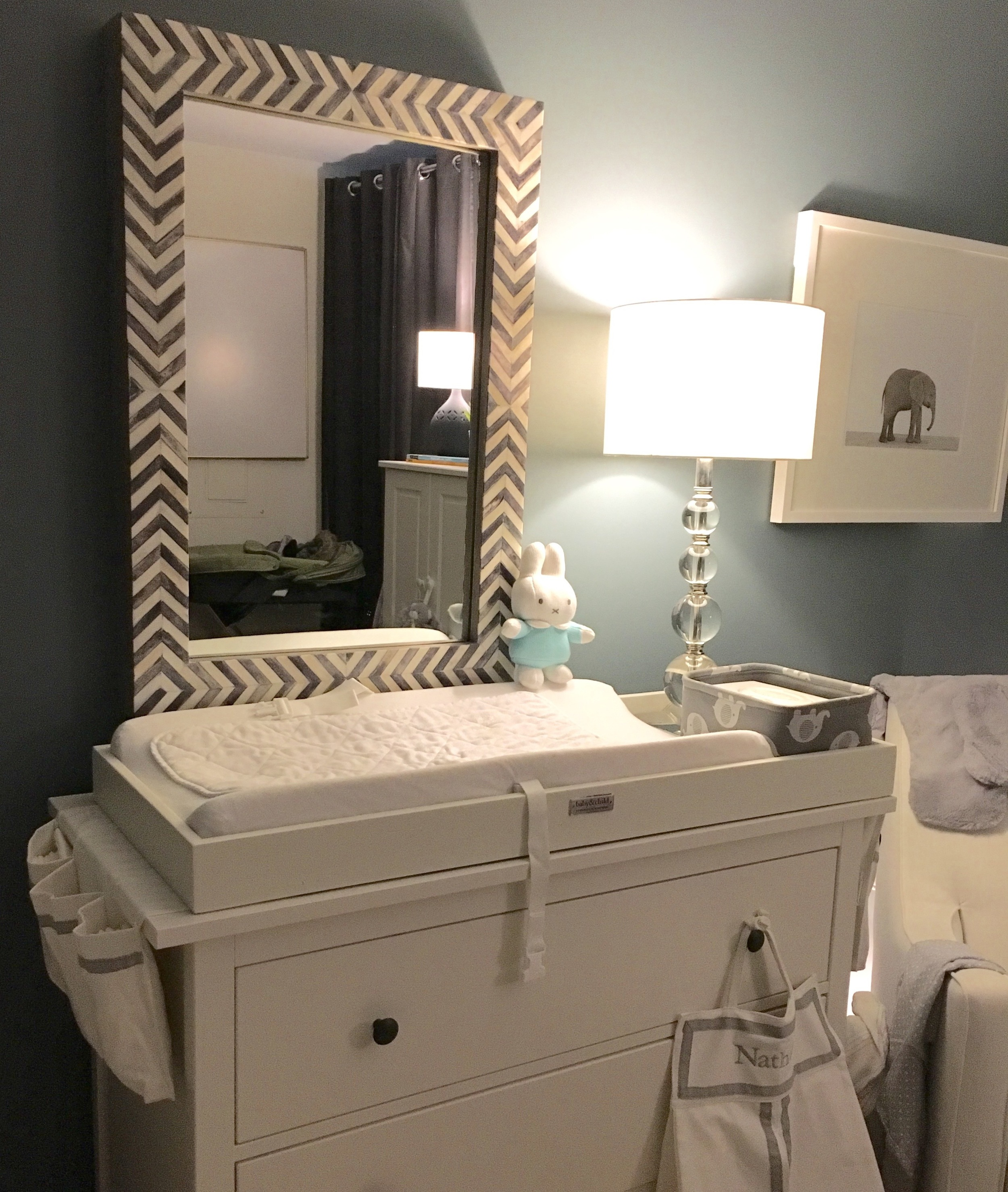 Ikea Hemnes dresser ,  RH Baby & Child Changing Topper ,  West Elm Parsons Wall Mirror , and  The Animal Print Shop baby elephant print