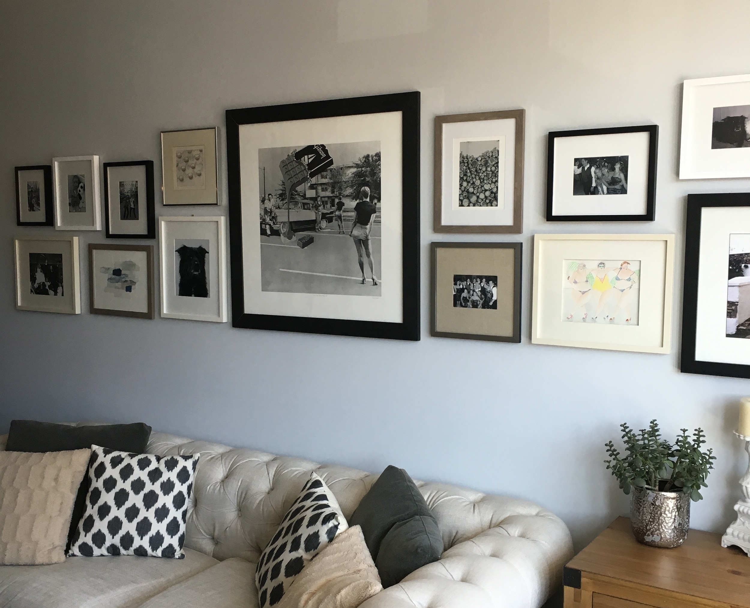 AFTER: A unique gallery wall featuring some of our favorite photographs and artwork.