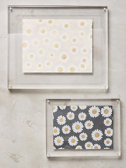 Acrylic Hanging Frames , $48-$58  These acrylic frames are just so cool. It's the perfect way to hang a piece of art in a less traditional space (like a kitchen or bathroom) and would make for a great minimalist gallery wall.