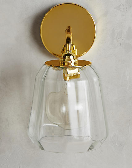 Salmar Sconce , $98  I've been searching for the perfect sconces for our dining nook (for what seems like years) and this just might be it. I love the look of clear glass with the brass, but for those who prefer color, these also come in a beautiful shade of silver or dark turquoise.