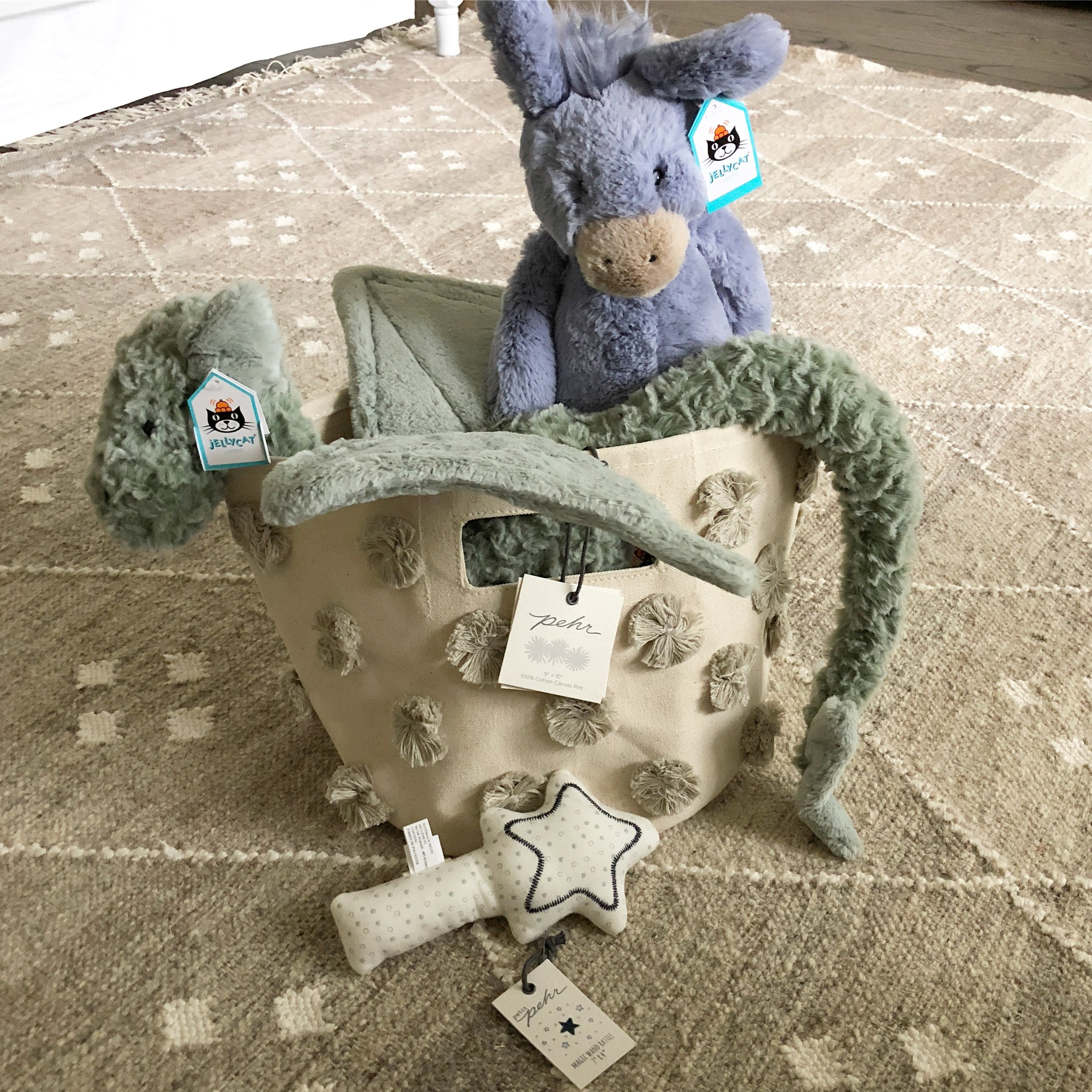 - Jellycat stuffed animals for Jacob and baby, as well as a few items from Pehr Designs (like this darling star rattle and pom pom bin) because I just couldn't help myself. Indigo's baby section is stocked with some of my favorite brands…