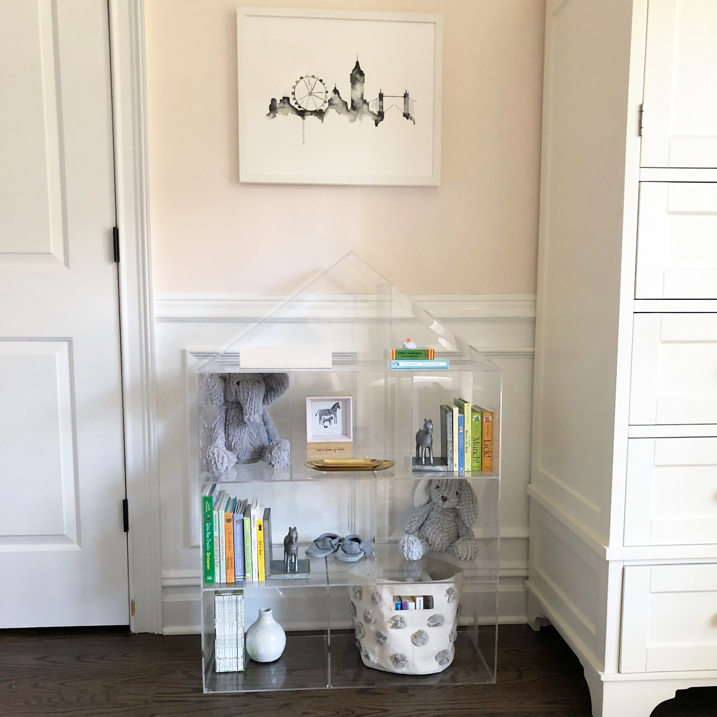 One of the only new pieces of furniture in the room: this acrylic dollhouse bookcase, which was too cute to pass up. Artwork is a piece we had hanging in our Hoboken apartment a few years ago!