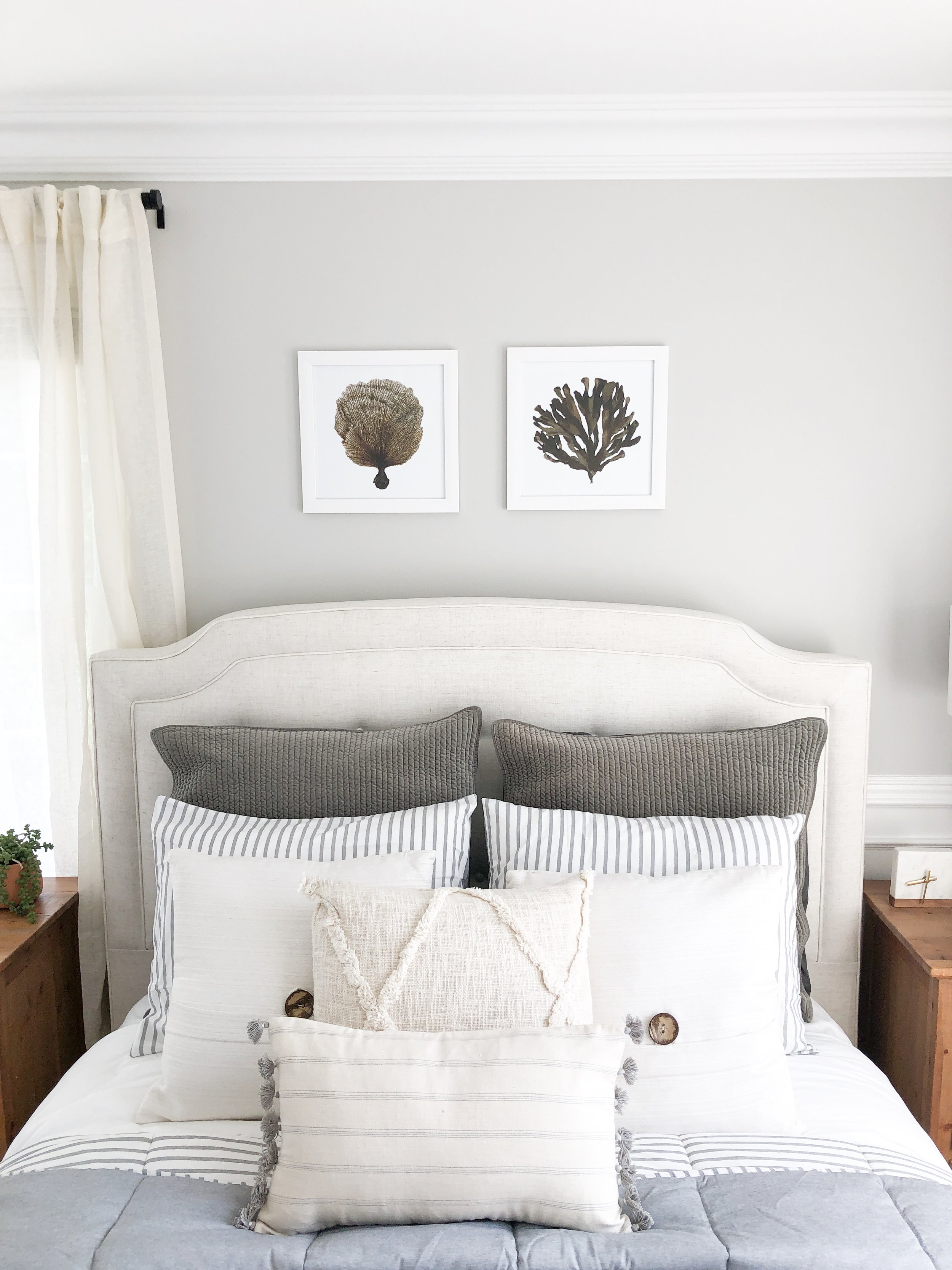 A set of summery prints hang over the bed. Art is an affordable way to update a room so go ahead and pick something that catches your eye! You can easily change it if the season (or your mood) changes.