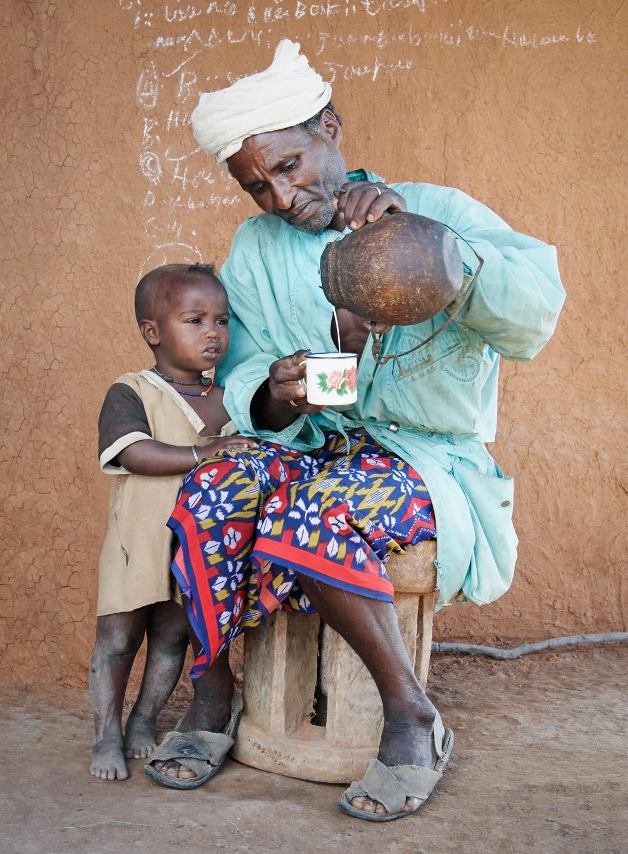 ethiopia-pastoralist-man-child-milk.jpg