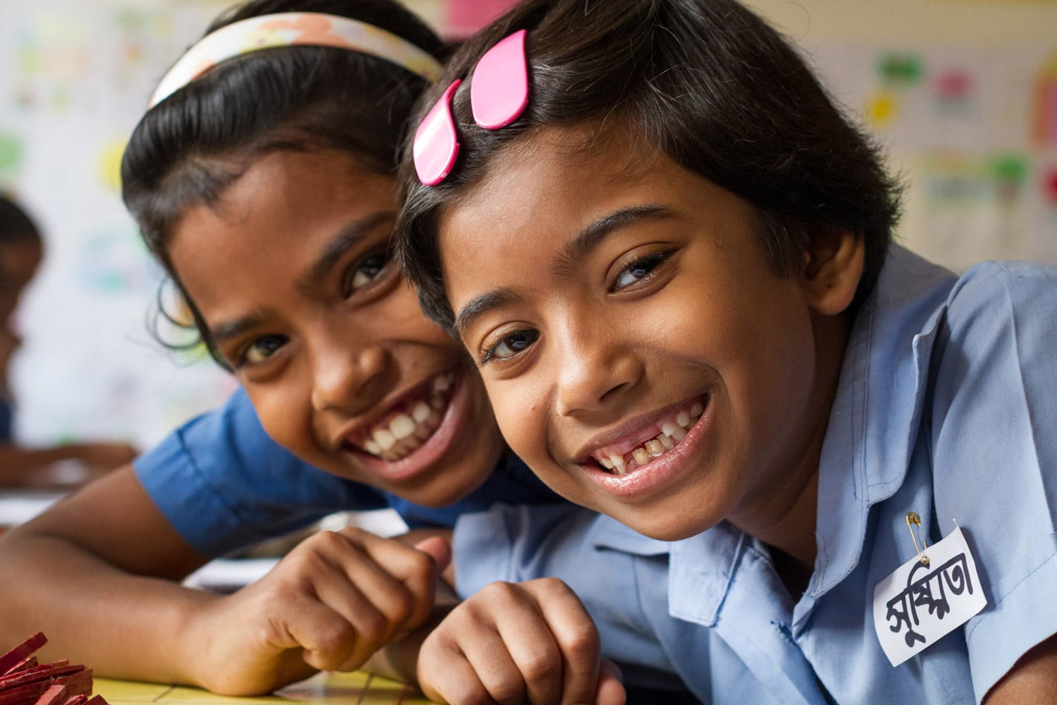 """Shushmita and her friend Binky pose for the camera. """"I love school because I get to play and I get to learn,"""" says Shushmita."""