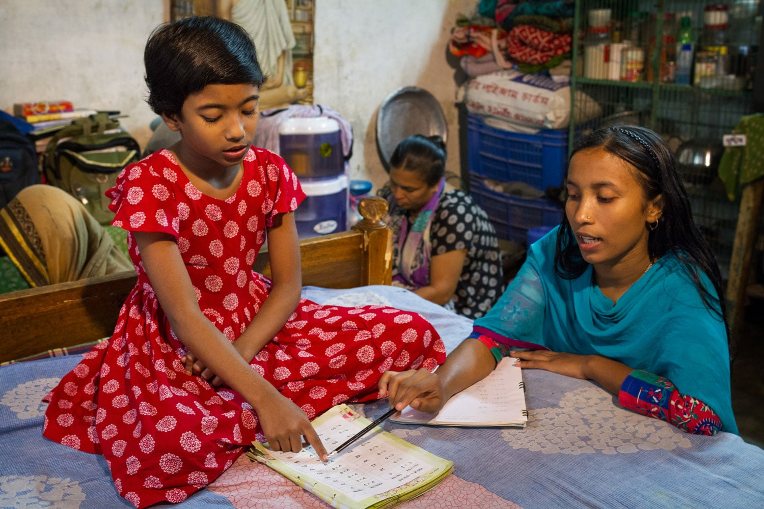 Shushmita's sister helps her with her schoolwork. Spending just three hours a day in school makes it difficult to provide children with the kind of quality education they need for a better future. As a result, most students in Bangladesh need to attend some sort of tuition program outside of school — an added cost that can be difficult for poor families to bear.