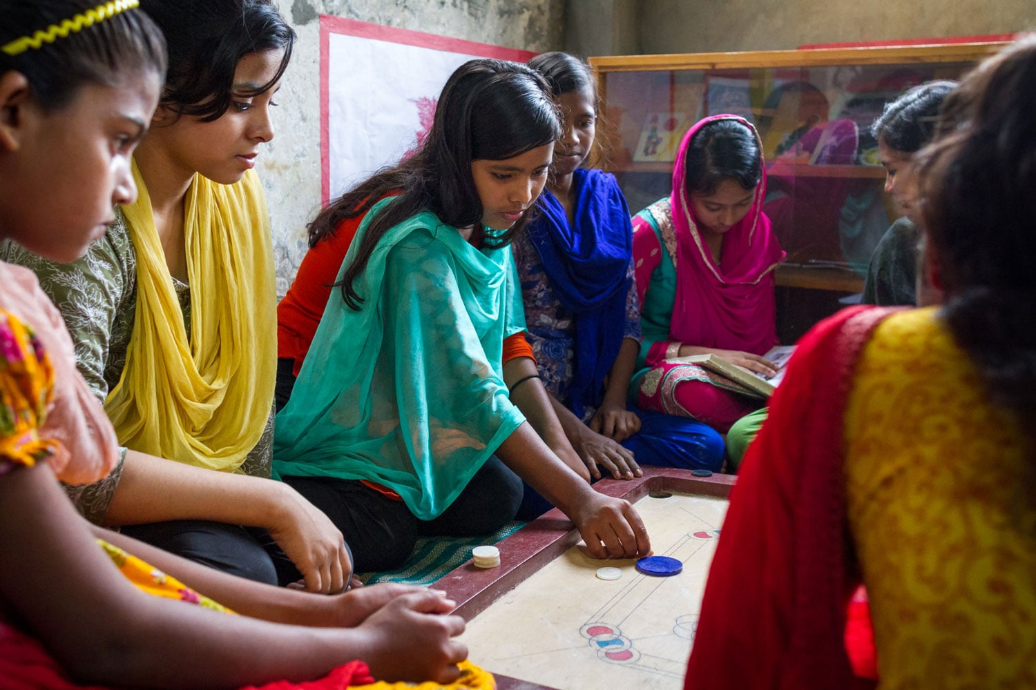 Moni plays a game with friends at a UNICEF-supported Adolescent Club near her home in Dhaka's Duaripara slum.