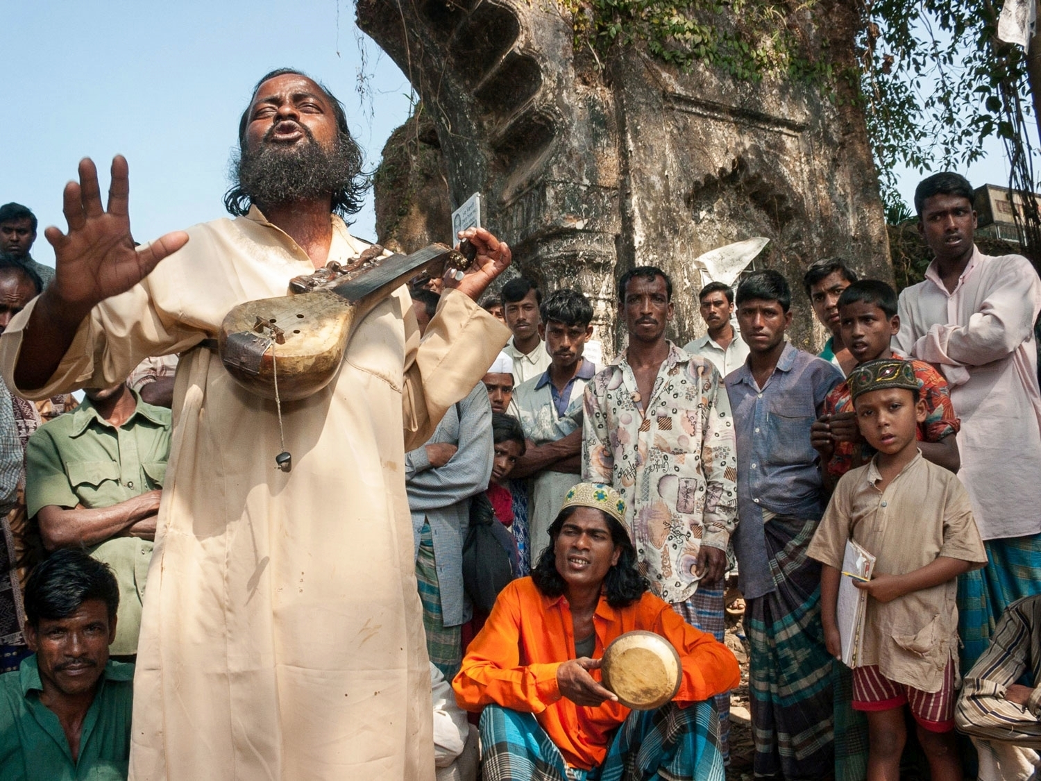 A Baul singer draws a crowd; Sylhet, Bangladesh