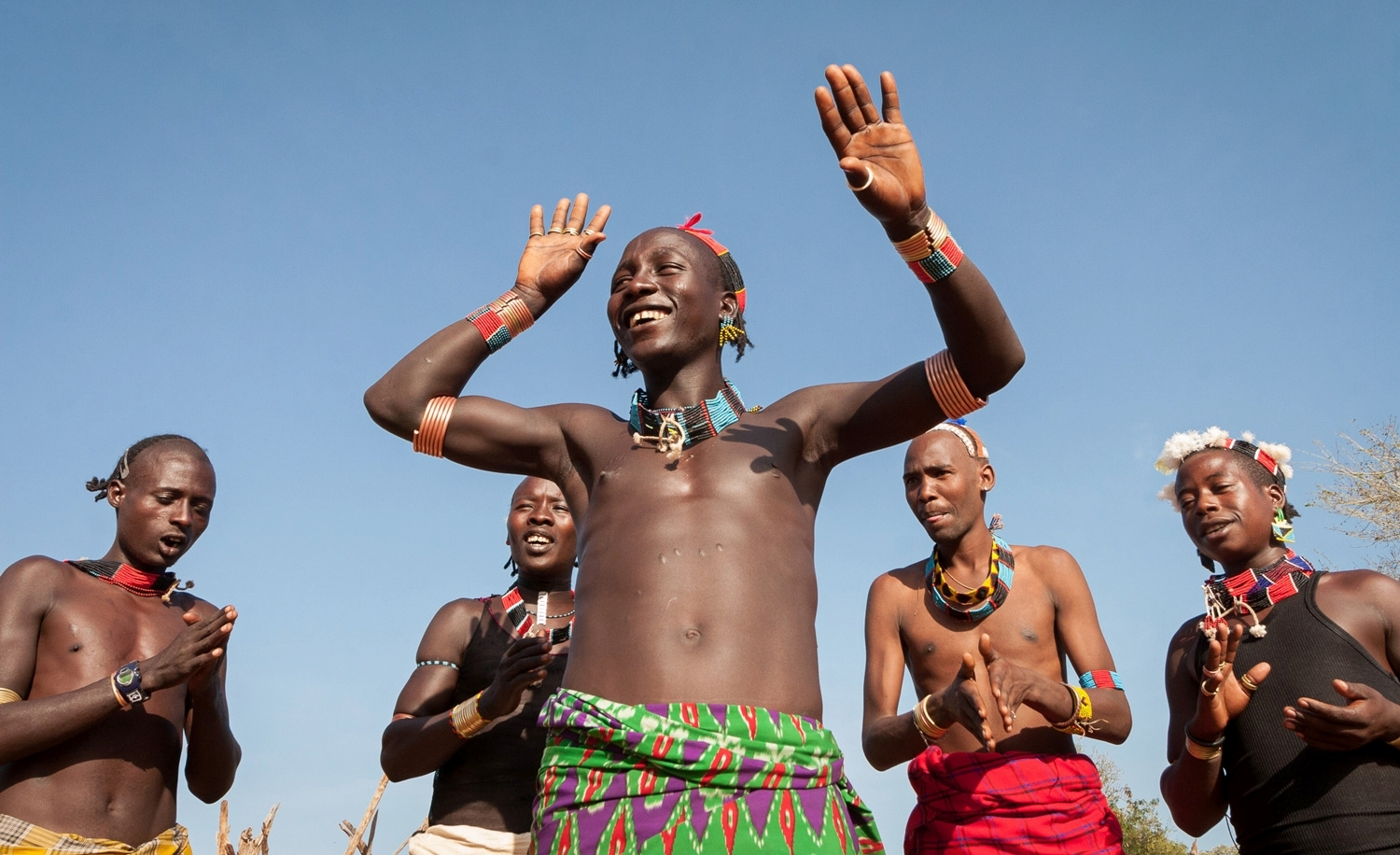 Ulde sings a song to celebrate his favorite ox; Omo Valley, Ethiopia