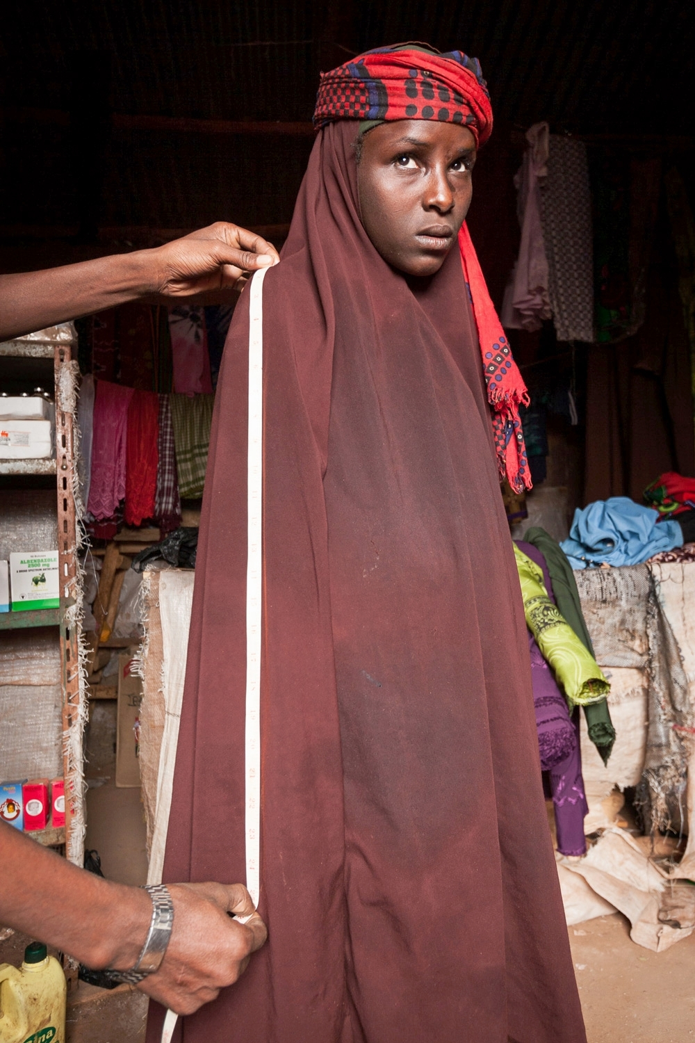 A tailor measures Habiba for new clothes in advance of her wedding; Ethiopia