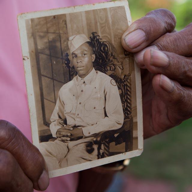 Arthur Guest holds his wartime portrait.  Photo:Linda Hervieux