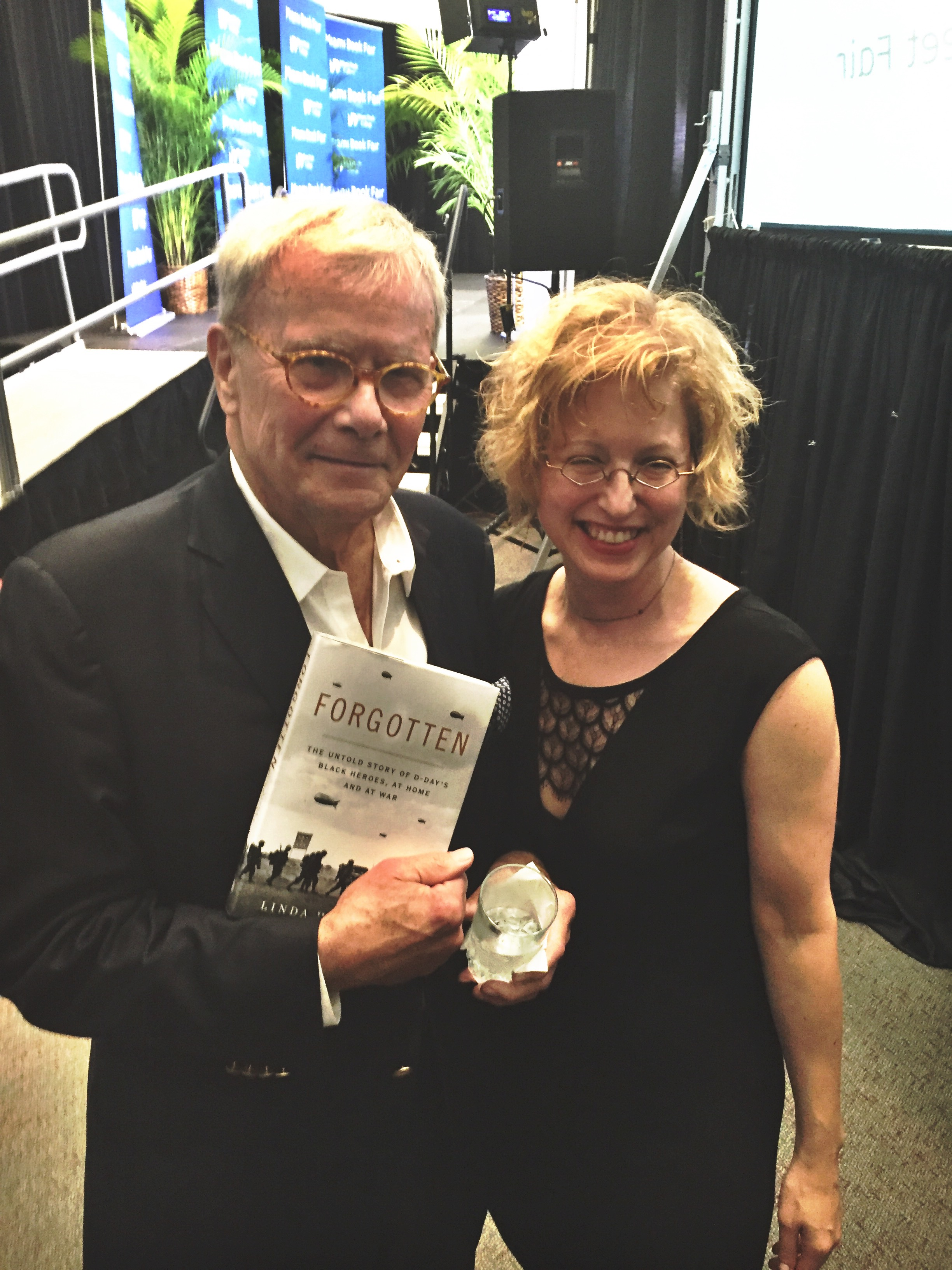Tom Brokaw with me and a copy of FORGOTTEN at the Miami International Book Fair