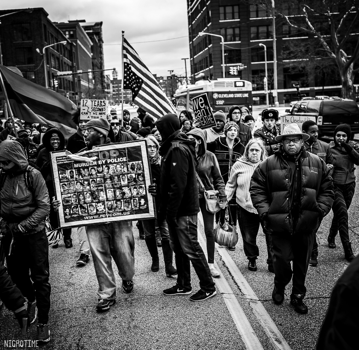 Charles See (far right) Director of Community Engagement observing the protest on December 29, 2015