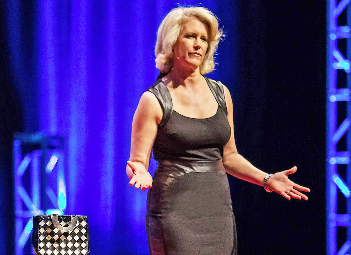Leslie Morgan Steiner giving a TEDx Talk in Seattle about her experience with domestic violence