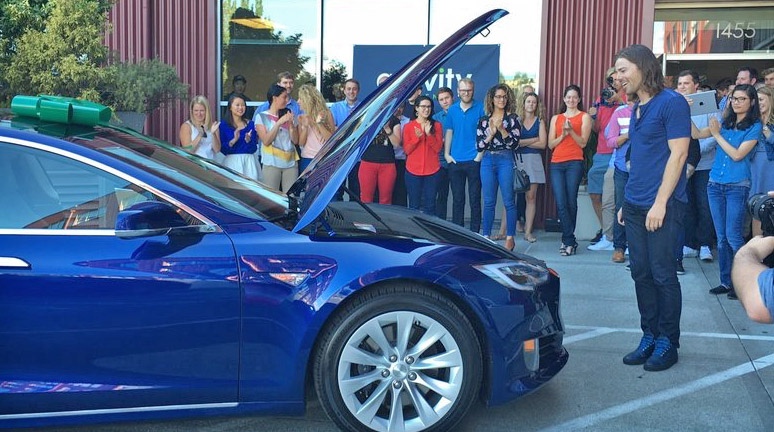 Gravity Payments employees buy a Tesla for their CEO, Dan Price