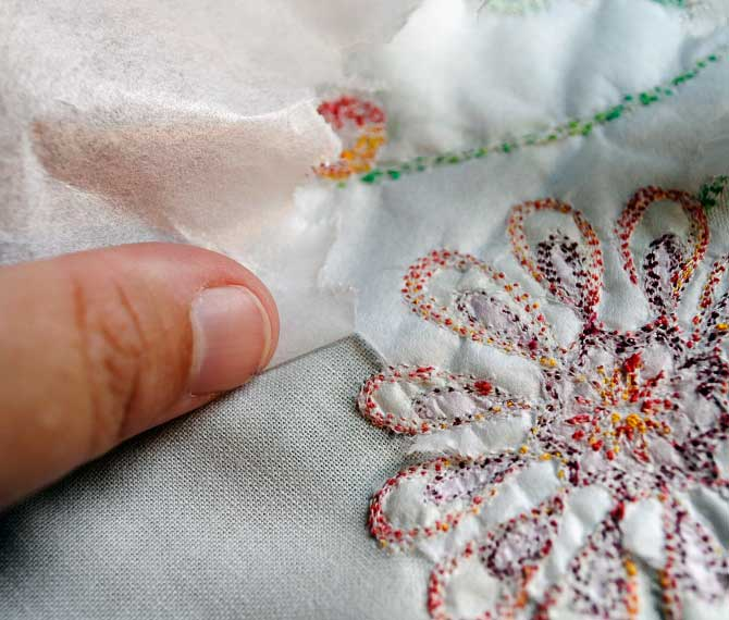 Pulling the interfacing away from the back of the fabric