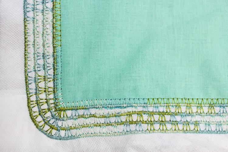 After 3 layers of decorative stitching and satin stitching.