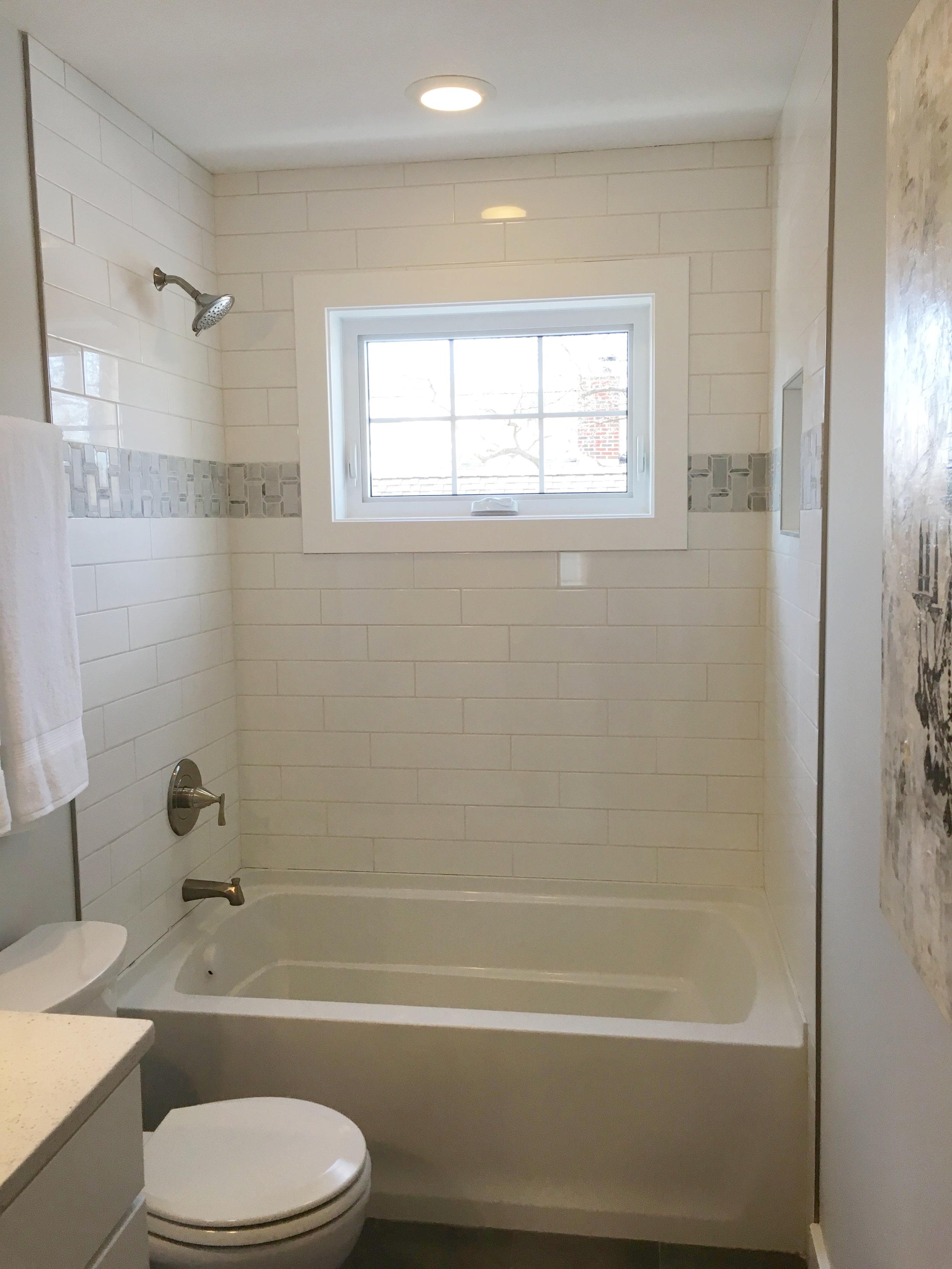 Enameled woodwork around a shower window