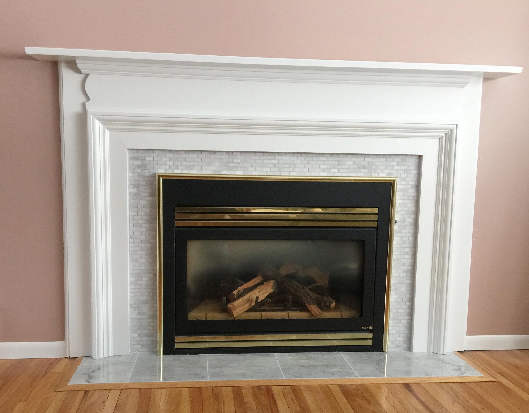 Enameled white fireplace mantel