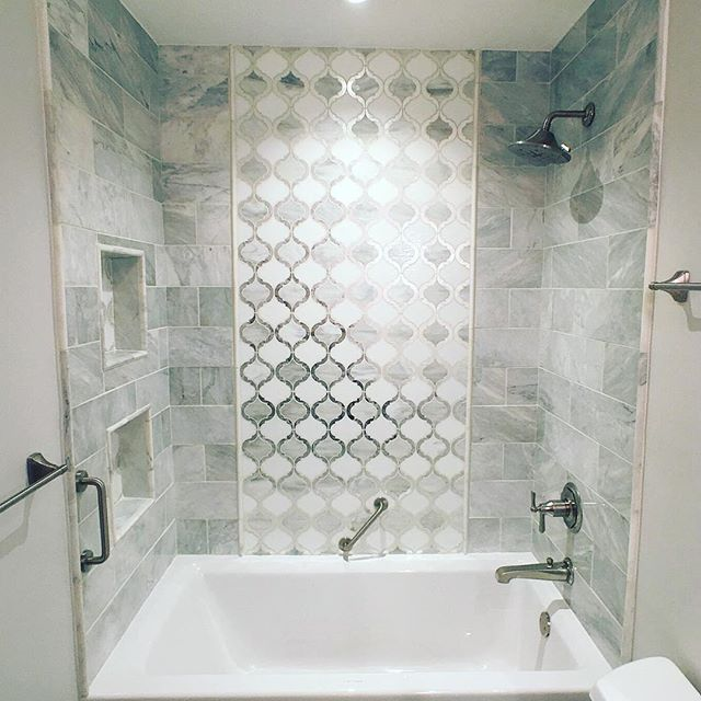 "Have you ever seen tile that took your breath away? 😍 ⠀ ⠀ Our client's didn't want their ""basic"" bathroom to look basic anymore, I think they accomplished that goal!"