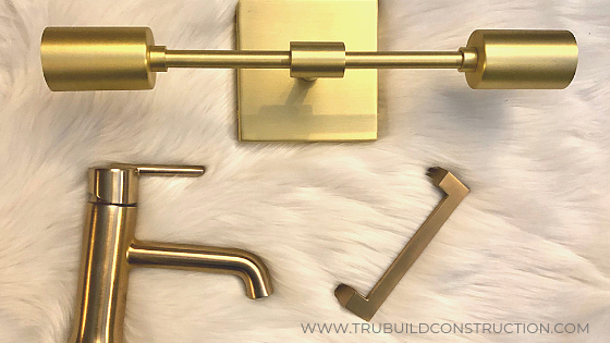 matching champagne bronze faucet, cabinet pull and light fixture
