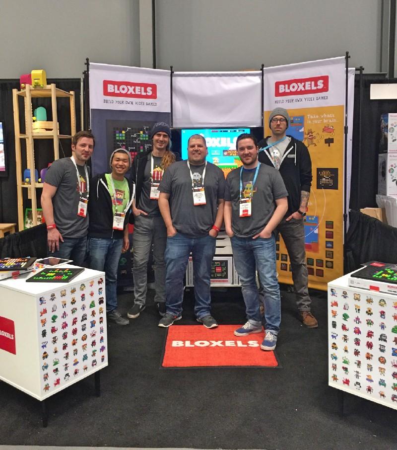 "Robin, Richard, Mark, Josh, Rob and Daniel wearing the ""Create-a-Character"" winning shirts."