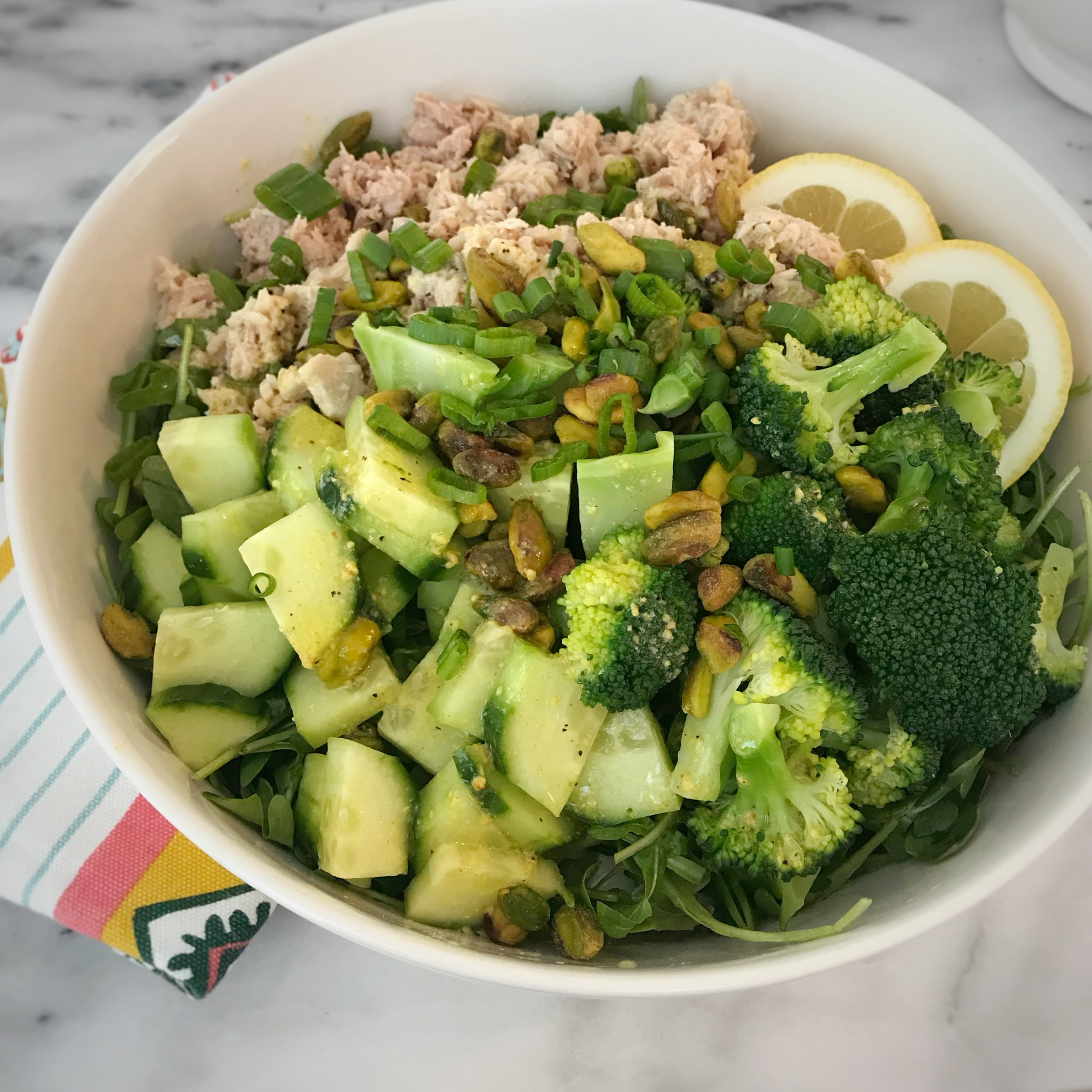 This is an under 10 minute meal that is easy to customize. Swap the veggies for your veggies of choice or swap the salmon for your favorite protein.