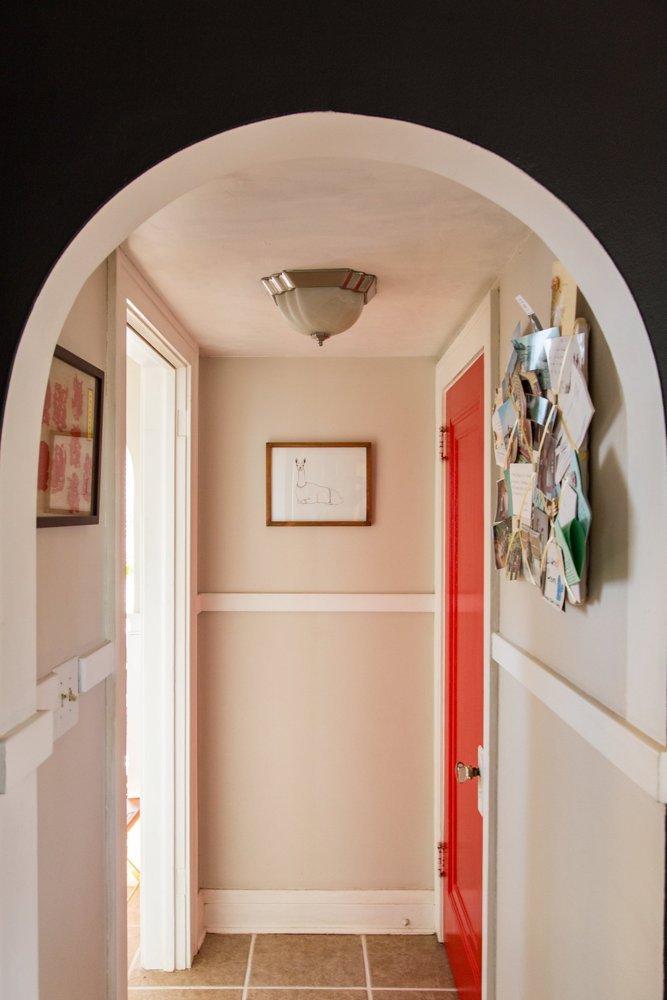 Image via Apartment Therapy. Paint color for door: Behr Flirt Alert