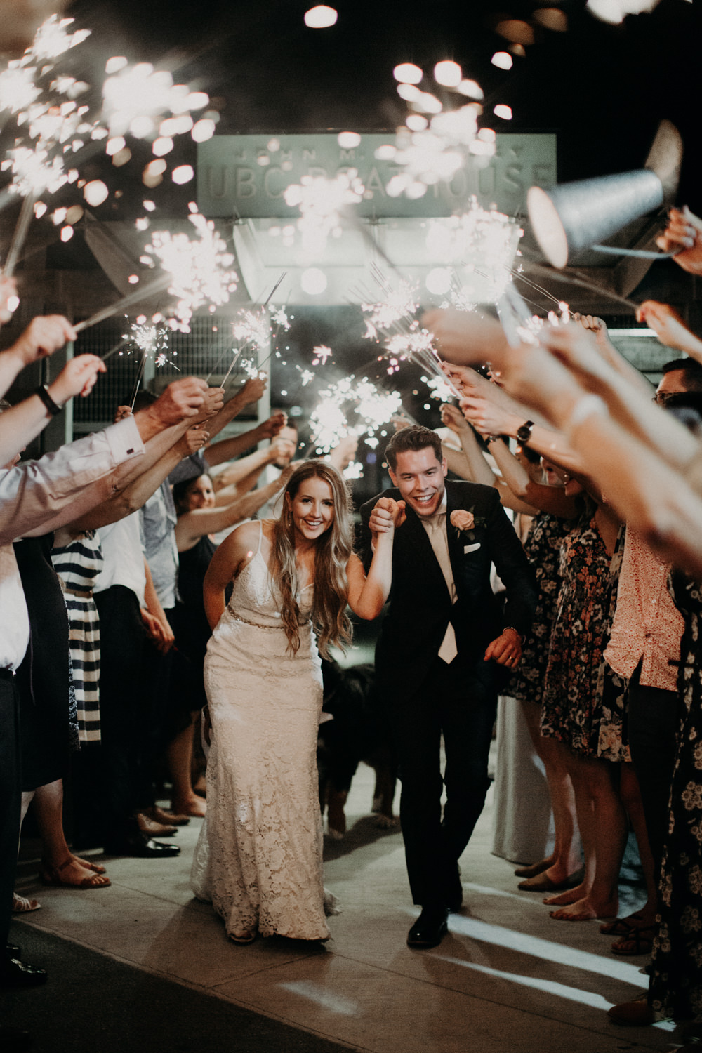 The bride and groom leaving their wedding via a sparkler exit.