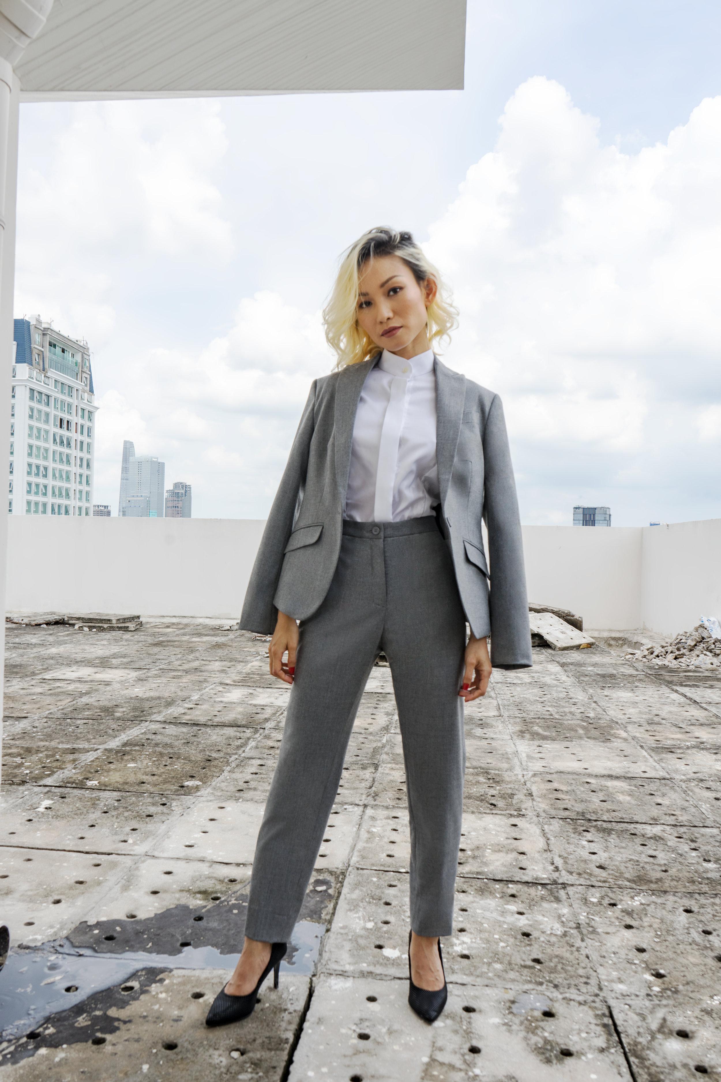 Woman's light grey pant suit