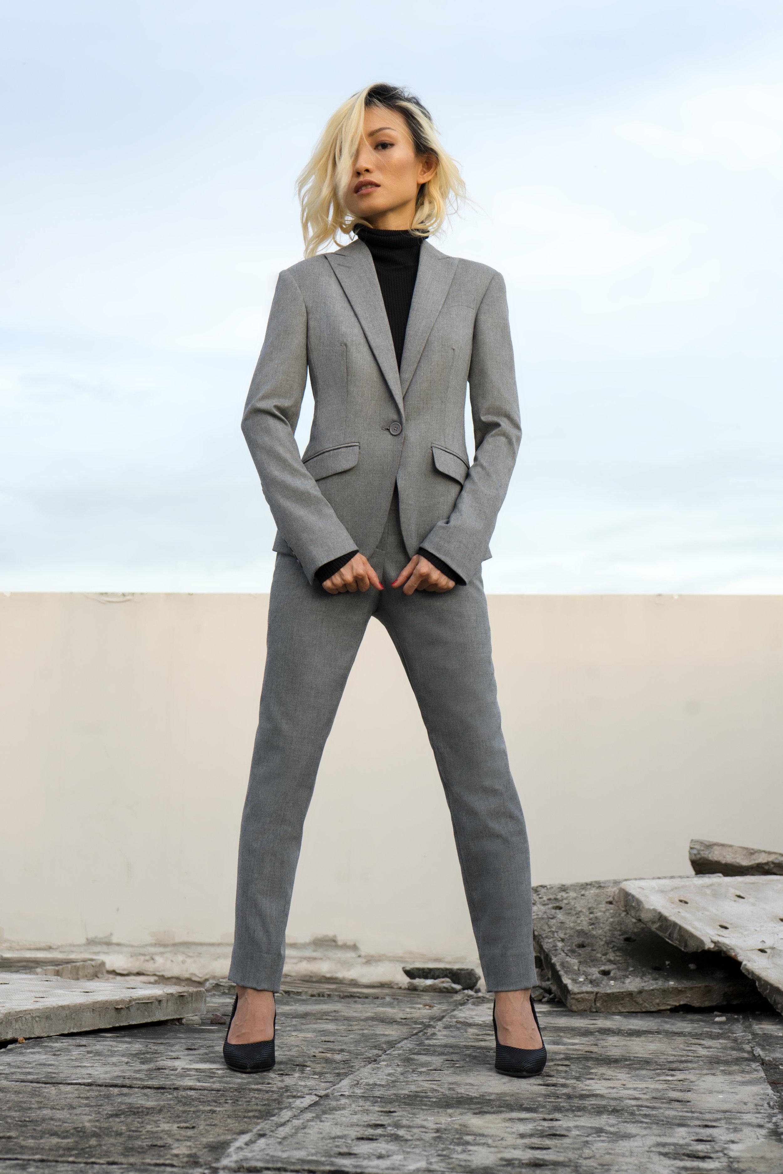 ladies' light grey pant suit with a black turtle neck top