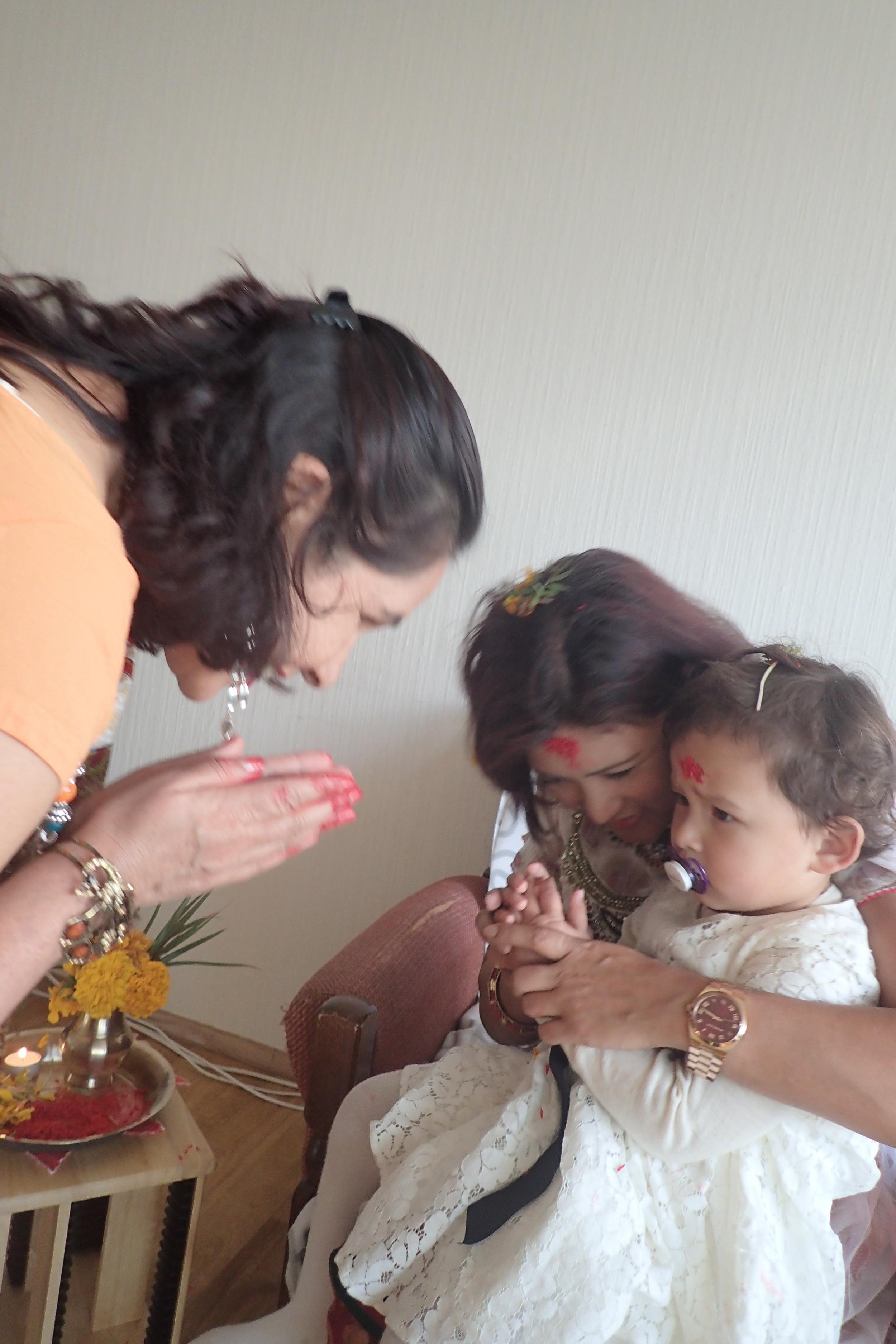 Little girl learning to greet 'Namaste'.