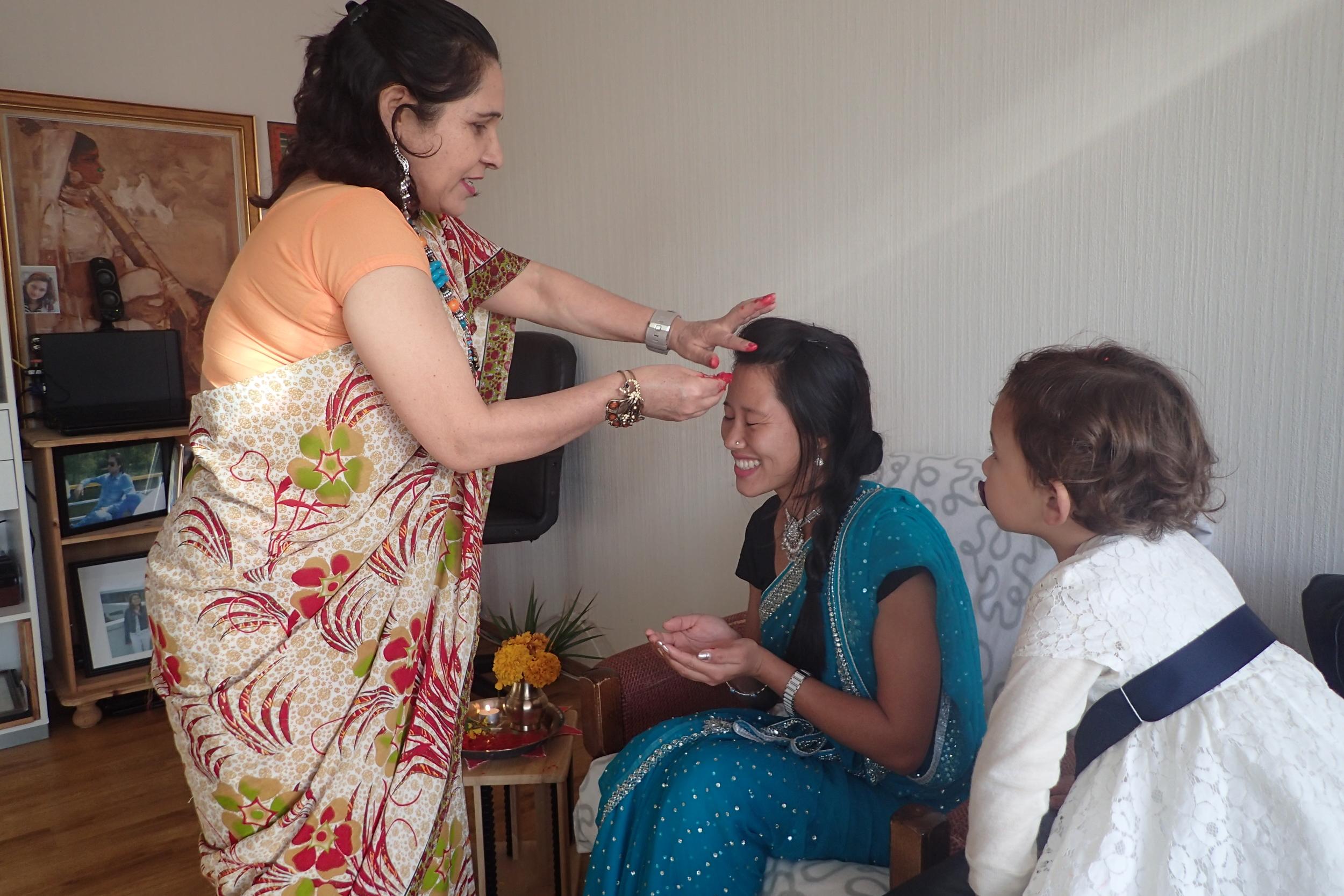 Ash Maya receiving Tika, Jamara and blessings :)