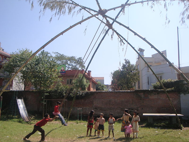 Children playing traditional Bamboo Swing