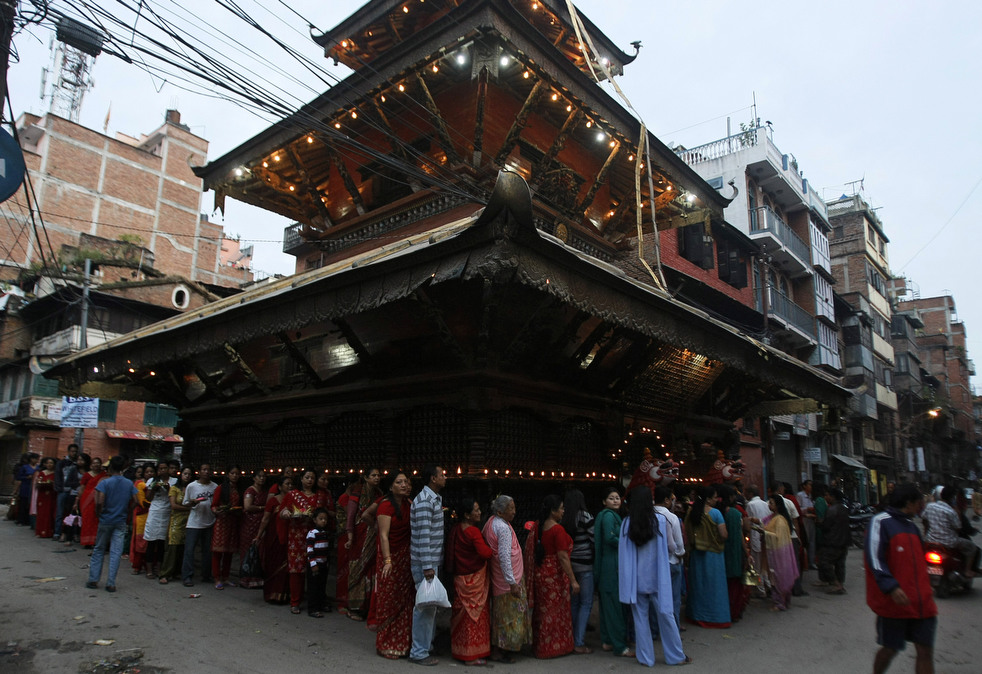 People waiting in queue to get into  the Temple.
