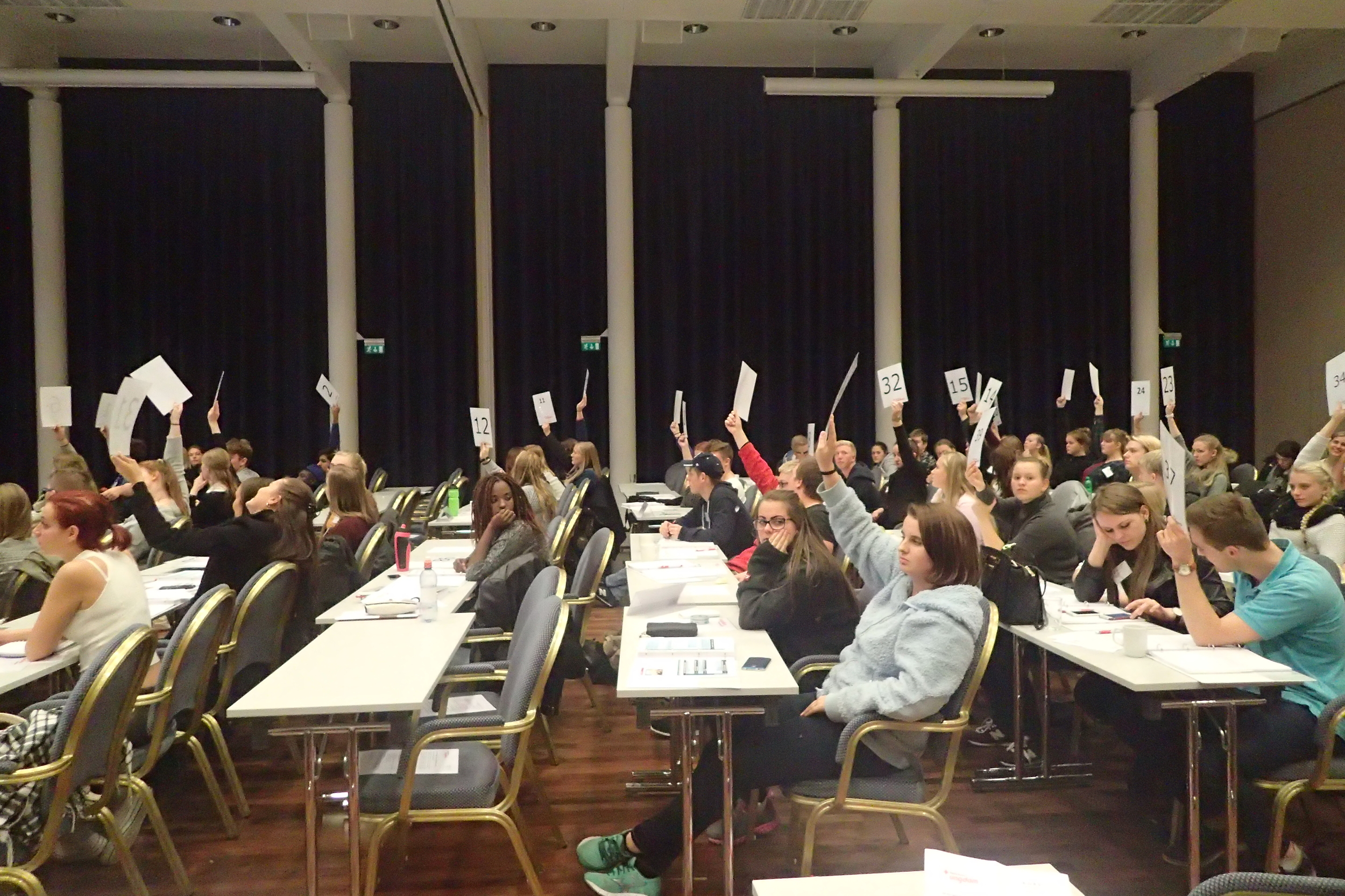 Delegates from different districts enjoying the rights of voting.
