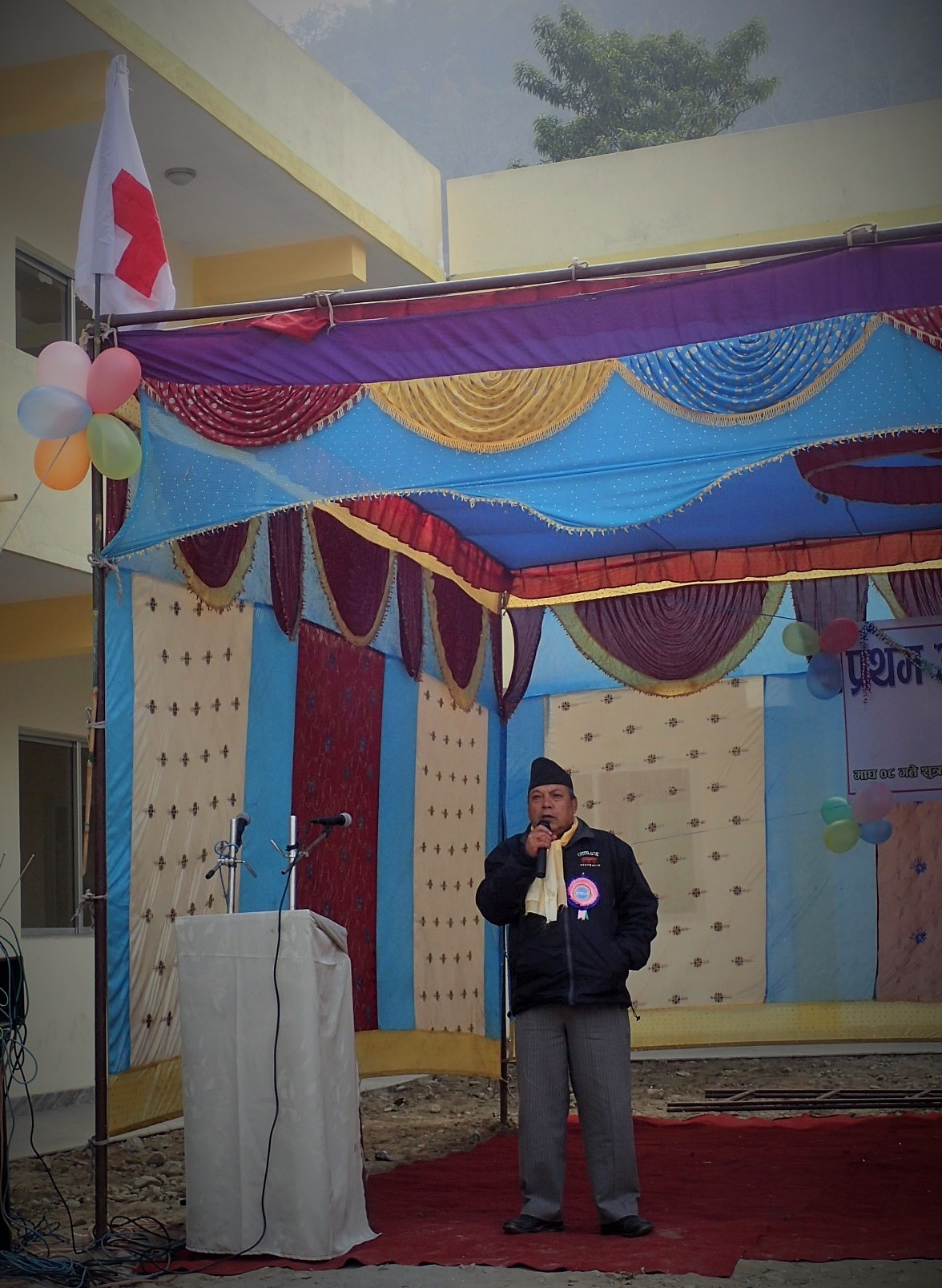 Red Cross President of Tanahun District Chapter, Mr. Gauli Sir, is giving his speech in the opening ceremony.