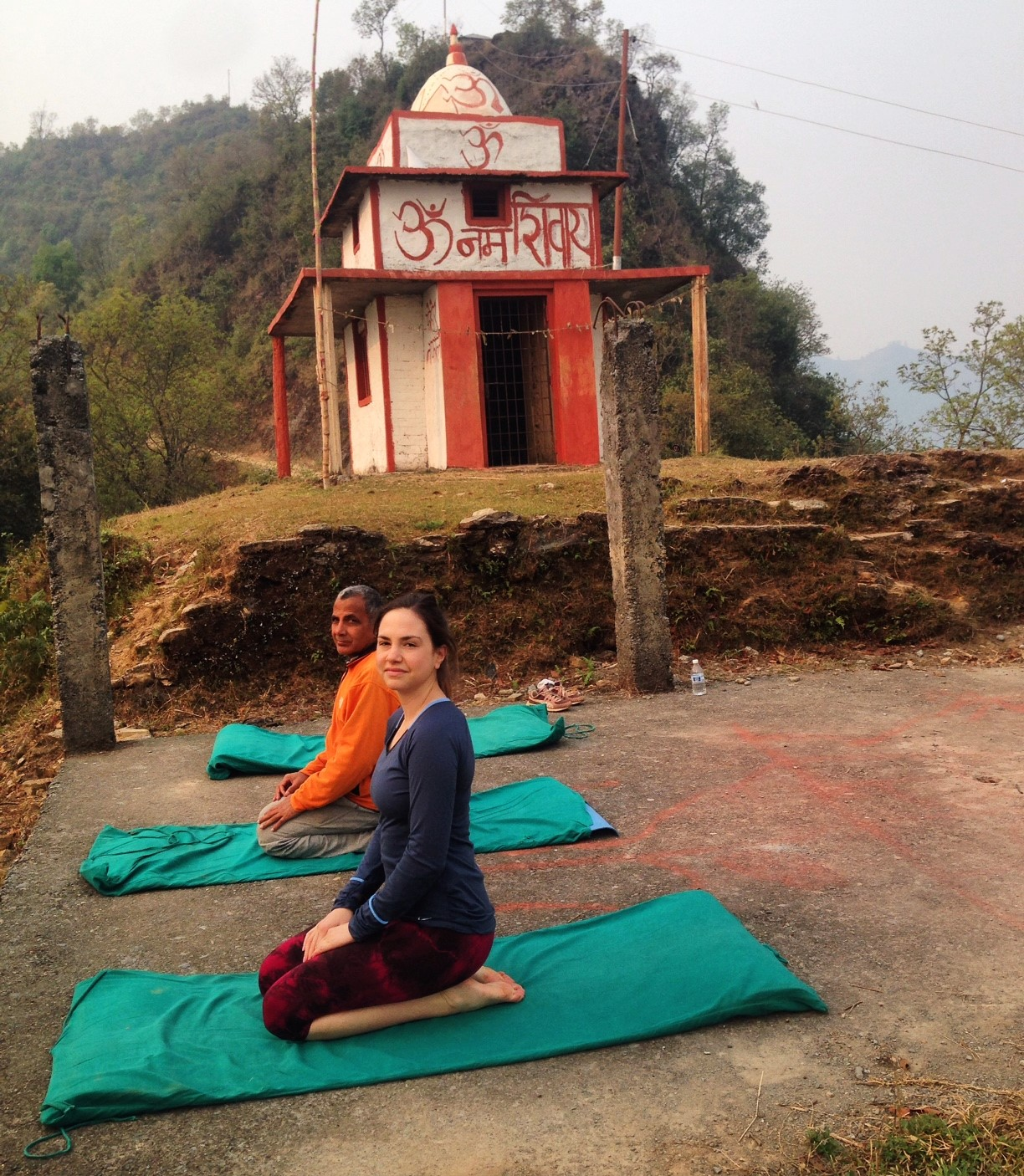 Practicing yoga 8 o'clock in front of the local Temple