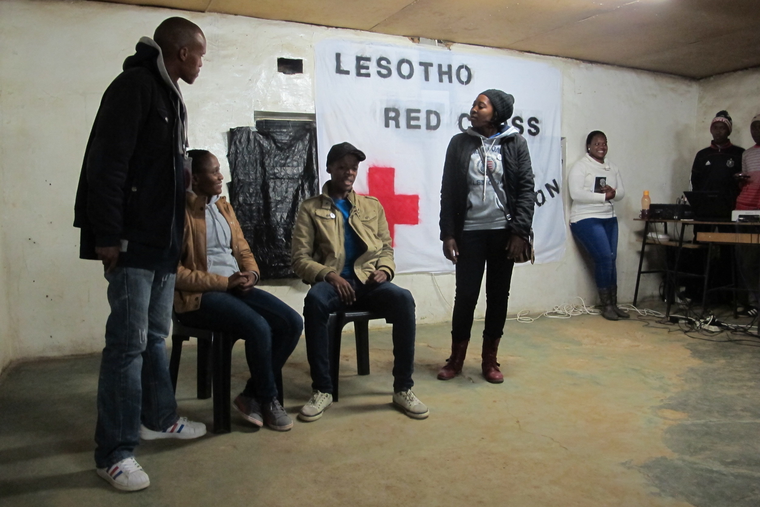 The youth officer and peer educators engaging in theatre