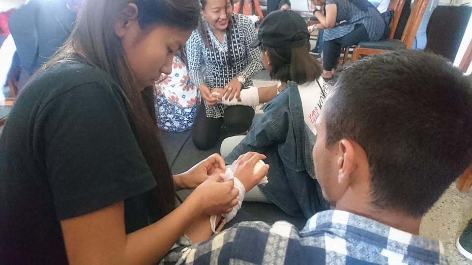 Youth Volunteers put on bandages