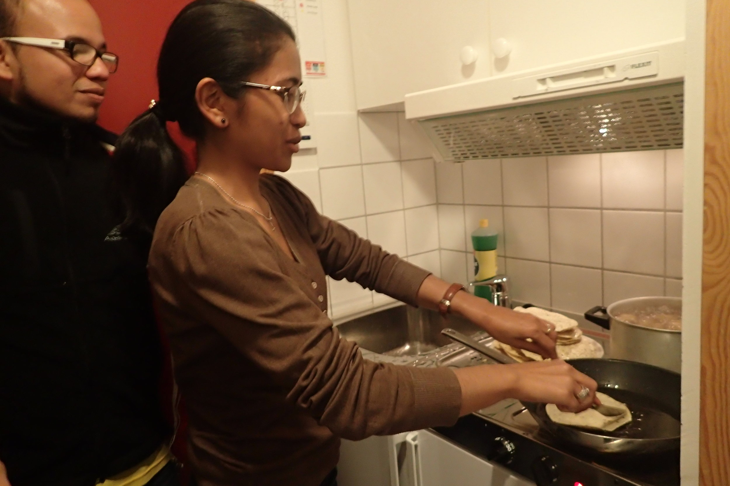 Learning how to prepare nepali foods by Malagasy and Colombian new youth delegates