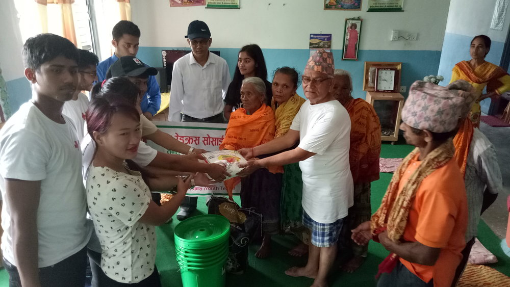 Youth Volunteers providing food to old people in Old Age Home, Damauli, Nepal  Photo Credit: Ola Opdal