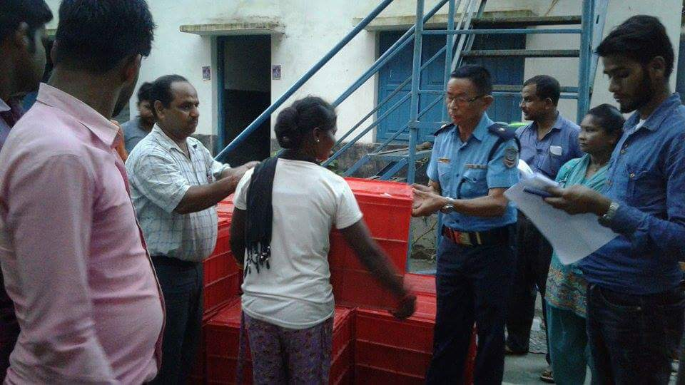 Delivering Relief aid to victims in presence of local police authority.