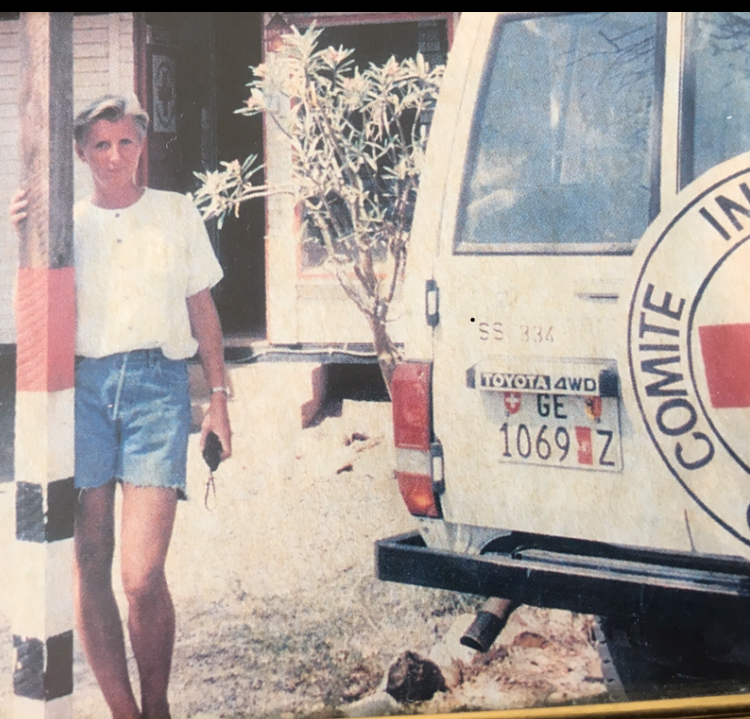Anne Kirsti next to the ICRC car during one of her first missions in Lokichokio , Northern Kenya in 1995.