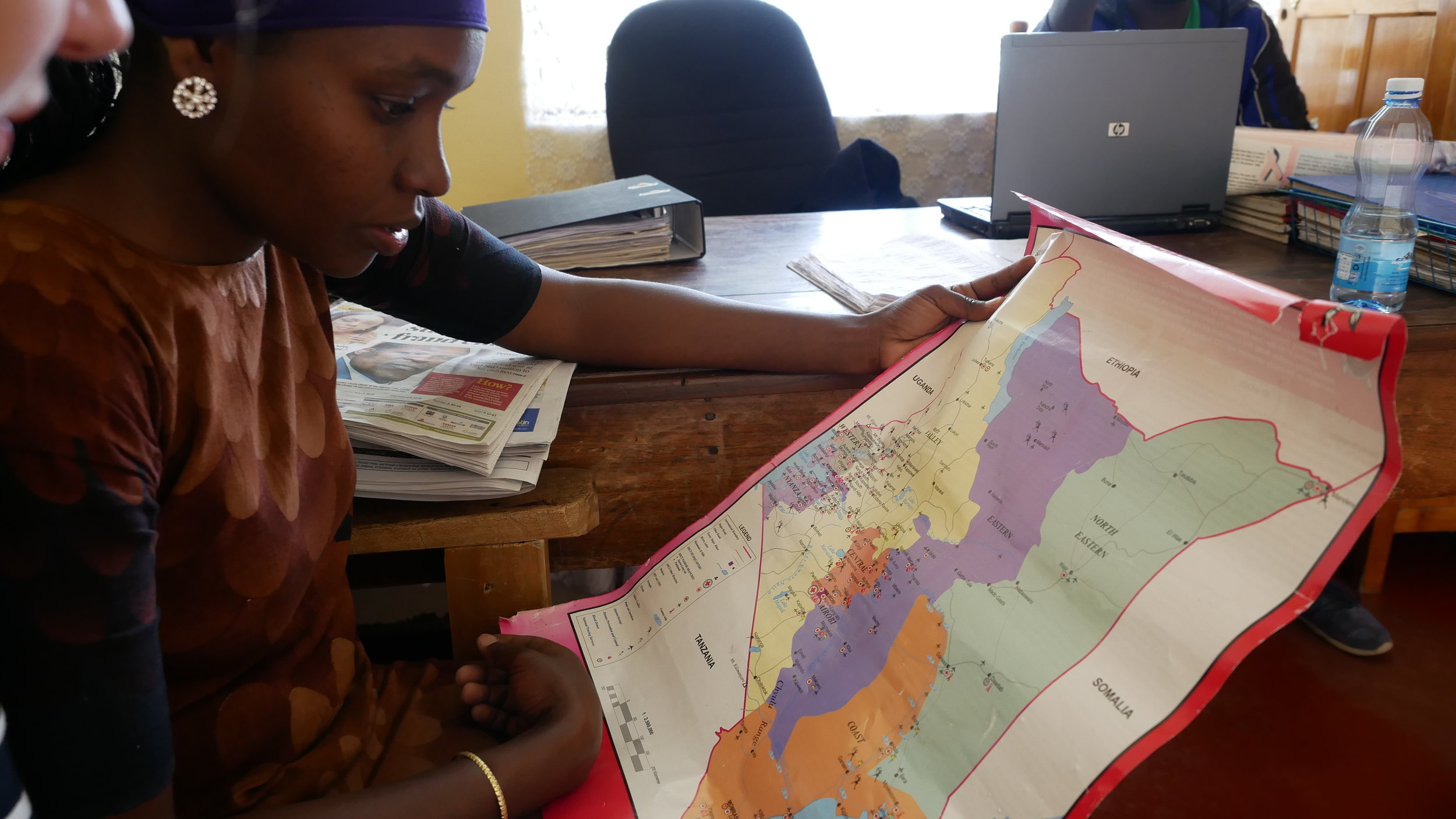 Grace, the office's intern, explaining Kenyan geography. Photo: Elfi Thrane Bemelmans.