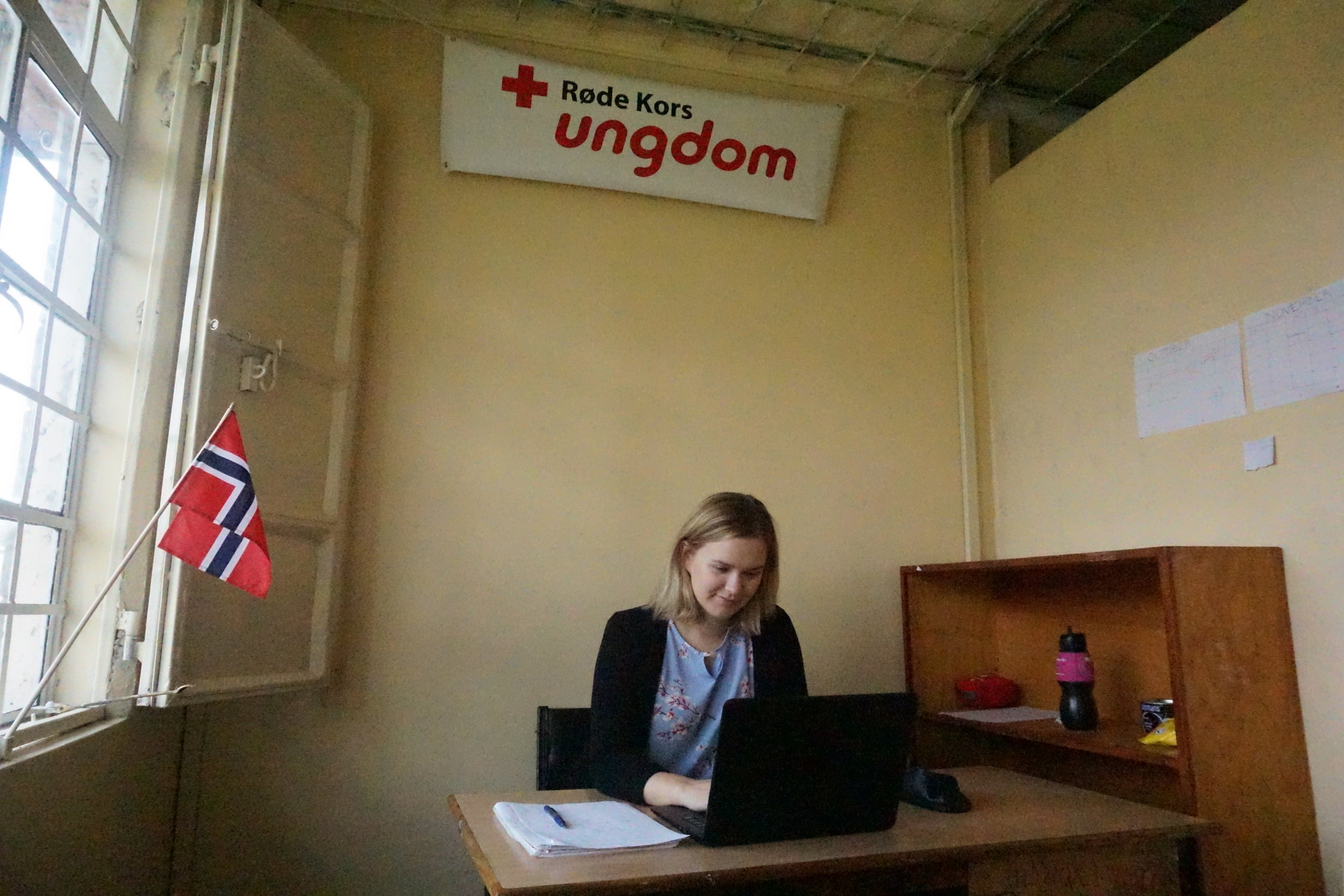 We have decorated our office with the Norwegian flag and the Norwegian Red Cross Youth banner.