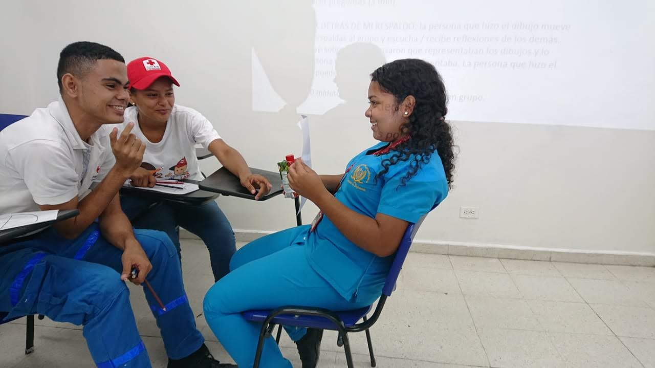 Youth volunteers participating in one activity.
