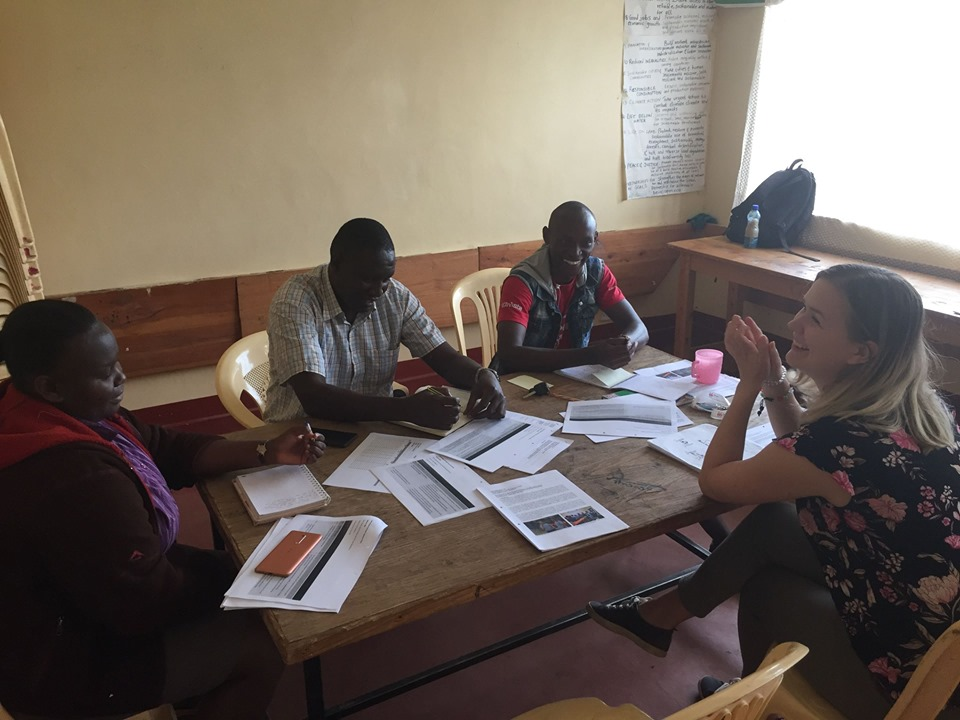 Youth Delegates discussing End of Mission reports with Laikipia Branch Coordinator Pauline Murithi, Board Chairman Harun Njuguna, and Youth Chair Edwin Kagiri. Photo: Elfi Thrane Bemelmans.