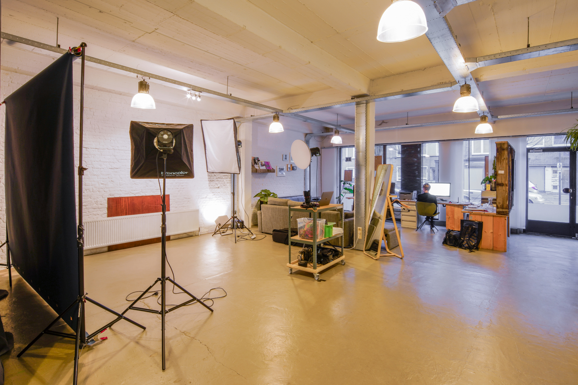 Overview of the photostudio. Shooting, desk and chill out space